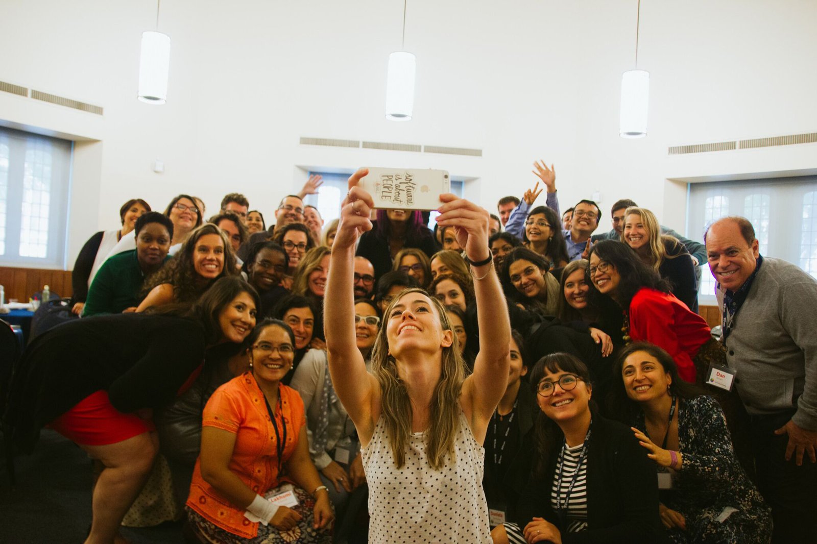 Sarah taking a selfie with a group of enthusiastic workshop attendees.